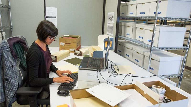 Archivist Kim Hayden works on cataloging the DEC photo library, part of the Digital Equipment Corporation corporate records processed under CHM APP.