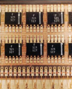Fairchild Block II flat package ICs on a printed circuit board. Photo: Charles Stark Draper Laboratory Archives