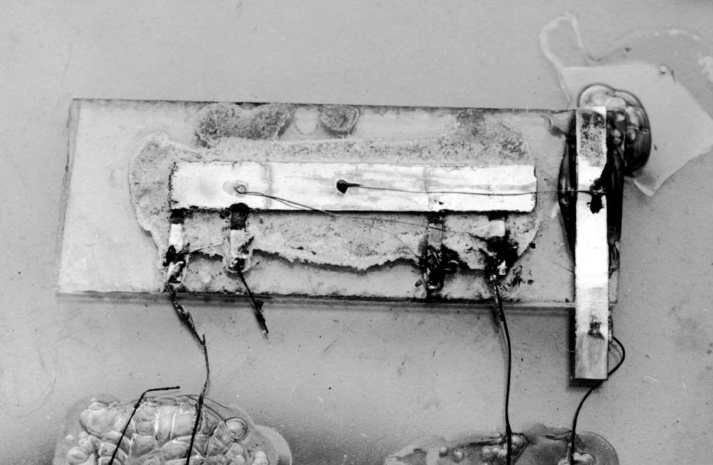 """Jack Kilby's """"solid circuit"""" with hand-wired connections. Photo: Texas Instruments"""