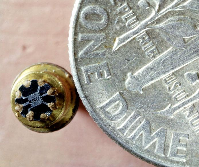"""Fairchild's first IC, the """"F"""" element flip-flop compared to a dime coin. Photo: Getty Images"""